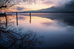 Syzygy 7/26 (jrobblee) Tags: ullswater lake england uk sunrise fence reflection water hills landscape mist silhouette