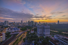 Aerial view of beautiful sunrise blue hour at Kuala Lumpur city skyline (MEzairi) Tags: aerial apartment architecture background beautiful beginning blue building business centre city cityscape cloudy commuter condominium day highway hour kl kuala landscape life lrt lumpur malaysia new office resident sea sky skyline skyscraper start station sunrise town train travel twilight urban view