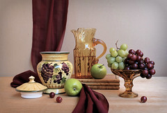 Matching Game (Esther Spektor - Thanks for 12+millions views..) Tags: stilllife naturemorte bodegon naturezamorta stilleben naturamorta composition creativephotography arrangement artisticphoto spring matching tabletop food fruit aplple grape cluster jar pitcher lid stand scarf drape glass ceramics pattern wooden water availablelight reflection green yellow burgundy marron amber brown estherspektor canon