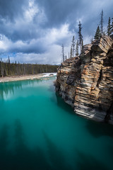 Athabasca River (robertdownie) Tags: trees canada blue north clouds pine stormy aqua cliffs arctic alberta rockies rocky mountains jasper athabasca river