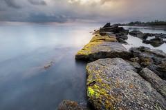 STUCK WITH YOU (jopetsy) Tags: sual pangasinan sunrise sunset seascape landscape fujifilm fuji philippines rain rock stones pebbles