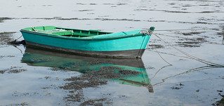 green boat reflection