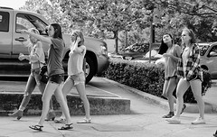 Girl's Day Out (burnt dirt) Tags: houston texas downtown city town mainstreet sidewalk street corner crosswalk streetphotography xt1 fujifilm bw blackandwhite girl woman people person friends crowd group fun laugh smile walking talking point tiara asian sandals shorts longhair boots heels tree bush