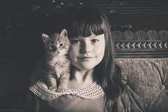 Anna & Rosebud (Kilkennycat) Tags: portrait cute girl cat canon children kitten child 50mm14 settee 500d kilkennycat t1i ryanconners