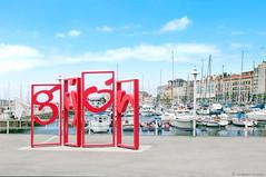 ciudad costera asturiana (LRCAN) Tags: espaa puerto nikon monumento asturias gijon rotulo deportivo lorcan d90 2013 principadodeasturias lorcanpictures gijnxixn