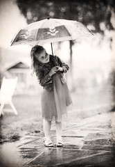 Singing in the rain......(Explored, my 139th) (Pewald) Tags: portrait people blackandwhite cute texture water girl rain sepia umbrella dress singing