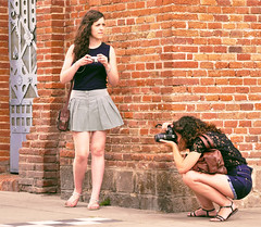 Taking pictures (chrisk8800) Tags: barcelona life street camera city girls friends portrait people urban face lumix photography photo nice spain eyes women pretty legs candid models young picture curls catalonia panasonic attractive denim shorts females g6 brunette appealing minishorts street life photography