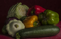 Dinner In Waiting (Bill Gracey) Tags: stilllife vegetables composition squash cabbage backdrop peppers onion veggies arrangement softbox brusselsprouts redpepper greenpepper redbackground foodphotography orangepepper directionallight offcameraflash tabletopphotography redcuttingboard yn560 yn560ii yongnuorf603n mariasarrangement