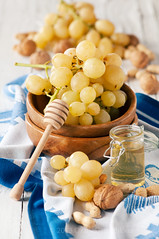 Yellow grapes and honey (Oxana Denezhkina) Tags: autumn summer food white plant color green nature yellow closeup fruit rural wooden vineyard healthy raw natural wine farm background cluster seasonal harvest tasty nobody fresh honey grapes bunch organic nut agriculture grape ripe ingredient