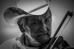 Zihuatanejo Mexico - Nov 13 - Pedro of Los Corales (2 of 3) (Ted's photos - For me & you) Tags: travel portrait bw beach face mexico blackwhite playa moustache pedro violin bow fiddle wrinkles zihuatanejo stetson bowstring 5photosaday wrinkledface loscorales playalasgatas tedsphotos natgeofacesoftheworld zihuatanejoguerrero vision:mountain=0699