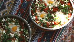 Shakshouka (Terin Talarico) Tags: africa food breakfast tomato mediterranean foodporn homemade eggs peppers parsley israeli anaheimpepper ragout harissa foodphotography foodgasm bakedeggs shakshouka foodstyling fetacheesepatternshakshukanorth