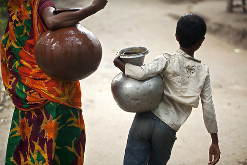 Bringing back water using pitchers in Khulna, Bangladesh. Photo by Felix Clay/Duckrabbit.