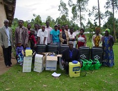 2017 community with sprayers and water tanks (Foods Resource Bank) Tags: foods resource bank frb world renew humanitarian food security smallholder agriculture development men women children community mulching conservation farming demo plots moisture retention soil fertility improvement yields beans maize potatoes cabbage vegetables
