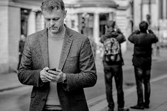 Snap Chat! (darren.cowley) Tags: candid text dof urbanscene photography city portrait blackandwhite monochrome moderntimes streetphoto darrencowley mobilephone