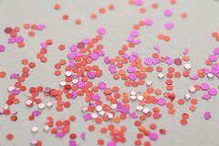 red pink glitter (freeimagesuk) Tags: red pink glitter flecks sparkles scattered random assortment white background macro closeup