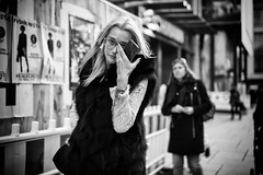 Staying focused (graveur8x) Tags: woman candid street portrait frankfurt germany glasses blond adjust people outdoor outside city deutschland strase streetphotography blackandwhite monochrome bw schwarzweis dof frau contrast urban breitling canon canoneos6d tamronsp45mmf18 45mm tamron focused tamronsp45mmf18divcusdf013