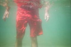 below the surface (.grux.) Tags: fujifilm quicksnap waterproof underwater film iso800 32mmlens plasticfantastic hands shorts red man submerged beach lakeontario torontoisland toronto