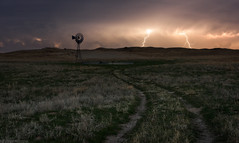 Prairie Turmoil (Erik Johnson Photography) Tags: red thunderstorm storm lightning stormchase chasing windmill long exposure leading lines trail midwest nebraska prairie sandhills mullen halsey national forest usfs usda public lands clouds mammatus grass grasses grasslands path bolt cg windmills