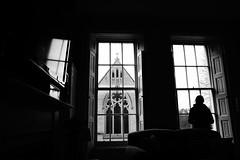 Looking In Looking Out (JamieHaugh) Tags: blackandwhite blackwhite monochrome bw figure window church looking indoors shutters furniture sony a6000 england bath uk britain