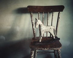 Rock-a-Bye (AJWeiss71) Tags: rockinghorse horse toy stilllife wood wooden primitive chair child children childhood lullabye mood moody atmosphere atmospheric nostalgia nostalgic animal solitude alone lonely old oldfashioned vintage antique decoration imagination memory memories object equine americana weathered amyweiss