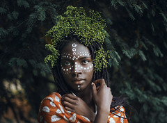 Huntress of serendipity (Enrico Cavallarin) Tags: queen nature wild wildlife facepainting black africa african plants green portrait skin face portraiture ritratto forest woods