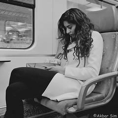 DSCN7119 (Akbar Simonse) Tags: holland netherlands nederland trein train traveller openbaarvervoer publictransport streetphotography streetshot straatfotografie straatfoto people candid girl zwartwit bw blancoynegro bn monochrome akbarsimonse vierkant square smartphone curls