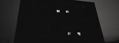 Portland (austin granger) Tags: portland oregon night windows illuminated correspondence geometry looming black squares city urban monolith film xpan