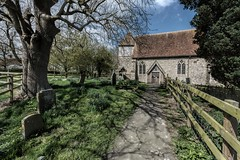 Church of St Peter and St Paul (James Waghorn) Tags: sigma1020f456 shadows spring tree church topazclarity fence gravestone kent d7100 clouds england medieval historic bilsington churchofstpeterandstpaul
