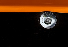 Flow, Interrupted (Karen_Chappell) Tags: bolt orange black metal steel vehicle tractor abstract stilllife paint painted stjohns
