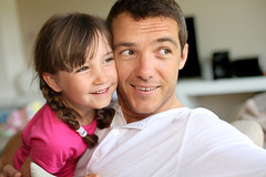 Portrait of daddy with little girl (kaannc7) Tags: family man girl kid child dad daddy father daughter complicity love braids hugging embracing cheerful happy smile smiling couch sofa home interior indoors adult 30s 4yearsold caucasian people france