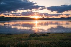Soda Lake Sunset (Kurt Lawson) Tags: bloom ca california carrizo clouds desert flowers grass lake mountains plain reflection salt soda sunset superbloom