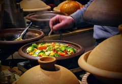 cooking with a tajine on the winter tollwood (peterschneider608) Tags: cooking tajine pentax k3 vegetables health healthy munich winter tollwood festival food street streetfood europe bavaria germany art delicious