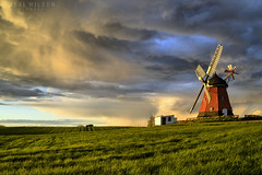 stormy clouds at the mill (Neal J.Wilson) Tags: windmills weather stormclouds stormy rain goldenhour sunlight mill windmill bjerre fields countryside denmark danishlandscapes danish oldbuildings nordic scandinavia jylland jutland landscapes europe