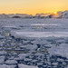sunset over drift ice