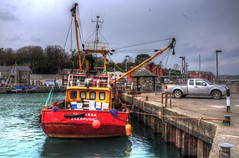 Working red (Shertila Tony) Tags: england sky haven water weather clouds port coast harbor boat town fishing europe cornwall day cloudy harbour britain jetty working hdr trawler padstow lannwedhenek