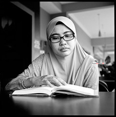 Square Portraiture - Ella Reading... (mankamen et ella) Tags: life bw woman slr 120 6x6 zeiss self square t reading women kodak c muslim hijab x cm 2nd hasselblad cycle 400 carl malaysia wife medium format 12 500 tri malaysian malay planar develop xtol 80mm ei800