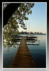 lake monona Pier (Digital_Third_Eye) Tags: summer sun lake tree green water skyline wisconsin docks canon pier afternoon framed capitol madison shore wi monona lakemonona danecounty 2013 650d t4i 18135stm