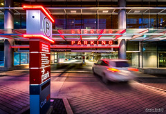 Parking (Alexis Birkill Photography) Tags: city canada car sign night vancouver dark lights downtown bc parkinggarage dusk britishcolumbia garage parking perspective trails conventioncenter vehicle lighttrails bluehour carpark hdr conventioncentre