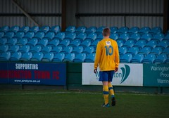 Playing to an Empty Crowd (tom_greaves) Tags: blue green grass yellow canon stand warrington cheshire 10 walk steel empty hoarding number seats ten pitch vignette reserves striker canon400d warringtontownfc cheshireleague