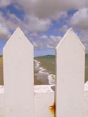 Days Bay (Tracy Christina) Tags: ocean travel newzealand sky clouds fence rust waves wellington northisland daysbay