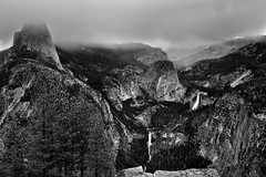 A View Across Illilouette Gorge to a Vista-like Setting with Mountain Peaks and Waterfalls (Black & White, Yosemite National Park) (thor_mark ) Tags: blackwhite capturenx2edited centralyosemitesierra cloudsacrossvalley cloudsaroundmountains cloudsinvalley colorefexpro day3 evergreens falls grizzlypeak halfdome hillsideoftrees illilouettegorge libertycap littleyosemitevalley lookingne lowclouds mountbroderick mountains mountainsindistance mountainsoffindistance nature nevadafall nikond800e overcast pacificranges panoramacliffs project365 sierranevada silverefexpro2 trees triptopasoroblesandyosemite vernalfall washburnpoint waterfalls yosemitenationalpark yosemitevalley yosemiterittersierranevada ca unitedstates