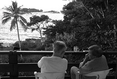 my parents...and their favorite place to be... (@petra (away)) Tags: monochrome summertime seaside house veranda people view palmtree woods nikon petra