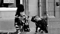 The new haircut (Fearghàl Nessbank) Tags: nikon d700 edinburgh bagpiper bw blackwhite street people mono monochrome