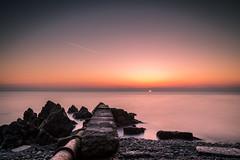 Naylors Cove (Minibert93) Tags: seascape sunrise sky pier wicklow rocks seaweed pipe rusty ireland canon water longexposure littlestopper