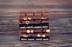 Stack of dark and milk chocolates on wooden table (♥Oxygen♥) Tags: candy closeup wood tasty nobody milk delicious copy dessert bar white sweet brown stacked stack ingredient pile wooden background board chocolate gourmet food nut pieces cocoa dark macro