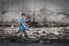 Wading Through the Rubbish (Trent's Pics) Tags: old port jakarta sunda kelapa child children harbor indonesia lifestyle litter people rubbish