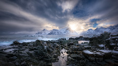 Winter in Mordor (explored) (hpd-fotografy) Tags: arctic flakstadøya lofoten norway bluehour coast cold crashing island landscape rugged seascape shore snow stones storm sunset ultrawide water waves winter