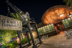 Down at Jock's Place (Adrian Court LRPS) Tags: aurorahdr bar blue chairs crane disneysprings florida glass green hdr jocklindseyshangarbar lights night restaurant signs stars tables towncenter usa villagelake wdw wing waltdisneyworld window