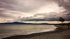 Clouds Over The Sea (Tassos Giannouris) Tags: clouds sea seascape trees landscape water waves winter greece kalamata overcast sky beach