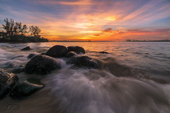 Against The Wave (My Pixel Magic) Tags: seascape landscape waterscape sunset rocks rockybeach wave sea burning sky